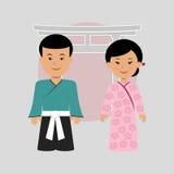 Человек и женщина в японских костюмах Стоковое фото RF