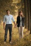 Человек и женщина идя в лес Стоковое фото RF