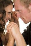 Человек и женщина смотрят головки с остроконечными шипами рук одина другого совместно стоковое изображение