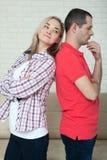 Человек и женщина стоя спина к спине после ссоры дома Стоковая Фотография RF