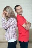Человек и женщина стоя спина к спине после ссоры Стоковые Изображения RF