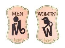 Человек и знак туалета дамы стоковое фото