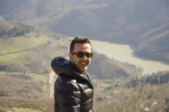 Человек и озеро Стоковые Фото