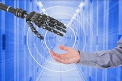 Человек и робот касаясь их рукам в голубой цифровой предпосылке Стоковые Фотографии RF
