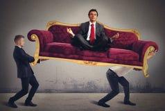 Человек йоги на софе Стоковое фото RF