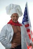 Человек кашевара на заднем плане американского флага стоковое изображение rf