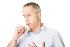 Человек кашляя из-за гриппа Стоковое фото RF