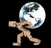 Человек коробки нося глобус Стоковое фото RF