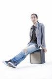 Человек моды джинсовой ткани на белой предпосылке Стоковое Фото