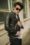 Человек моды закрывая его куртку Стоковая Фотография RF