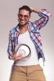 Человек моды принимая его шляпу Стоковые Фотографии RF