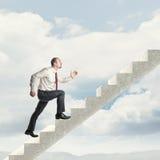 Человек на лестнице Стоковое Изображение