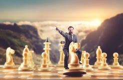 Человек на диаграмме шахмат стоковое изображение rf