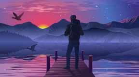 Человек на пристани восхищая заход солнца Стоковая Фотография