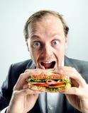Человек не совсем чистого дела есть сандвич Стоковое Фото