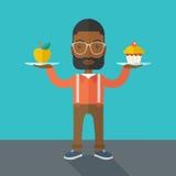 Человек носит с его 2 руками пирожным и яблоком Стоковые Фотографии RF