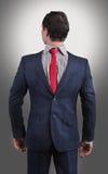 Человек нося его костюм дальше ОН назад стоковые изображения rf