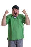 Человек нося зеленую рубашку празднуя стоковые фотографии rf