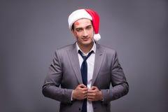 Человек нося santa в смешной праздничной концепции Стоковое Фото