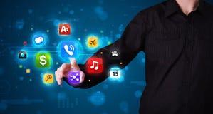 Человек отжимая различное собрание высокотехнологичных кнопок Стоковые Фотографии RF