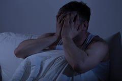 Человек отчаяния покрывая его сторону Стоковая Фотография RF