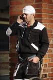 Человек печной трубы вызывая к клиенту Стоковые Фото