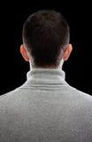 Человек поворачивая его назад Стоковое фото RF