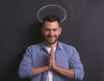 Человек показывая ангела Стоковая Фотография RF