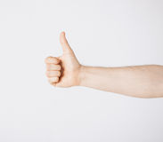 Человек показывая большие пальцы руки вверх Стоковое Фото