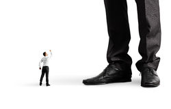 Человек показывая кулак к его большому боссу Стоковое фото RF