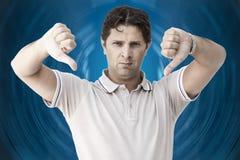 Человек показывая оба большого пальца руки вниз Стоковые Фотографии RF