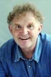 Человек портрета белокурый смотря возбужденный Стоковое Изображение
