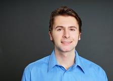 Человек портрета на голубой рубашке Стоковое Изображение