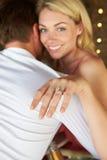 Человек предлагая к женщине Стоковая Фотография RF