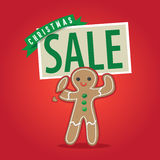 Человек пряника держа знак продажи рождества Стоковое Фото
