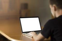 Человек работая на тетради Стоковая Фотография RF