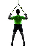 Человек работая силуэт trx тренировки подвеса Стоковая Фотография RF