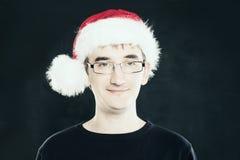 Человек рождества Реальный человек в шляпе Санты на классн классном Стоковое Изображение RF