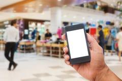 Человек руки держа умный экран белизны телефона стоковое фото