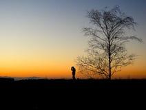Человек силуэта с шляпой Стоковая Фотография RF