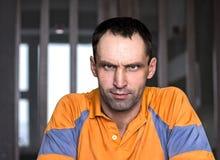 Человек сидя дома Стоковые Фото
