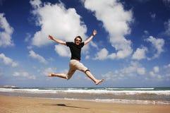Человек на пляже Serie Стоковое Фото