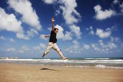 Человек на пляже Serie Стоковое фото RF