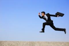 человек скачки дела счастливый Стоковые Фото