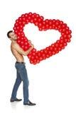 Человек смотря прищурясь через форму сердца Стоковое Изображение