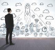 Человек смотря startup эскиз Стоковая Фотография