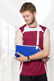 Человек спорта с рукой в слинге Стоковое Изображение RF
