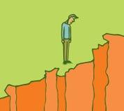 Человек стоя на краю скалы Стоковое Изображение RF