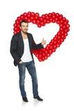Человек стоя с формой сердца Стоковые Изображения RF
