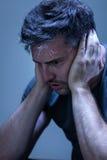 Человек страдая от нервного расстройства Стоковое фото RF